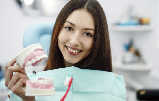 Girl with toothbrush in hand and teeth